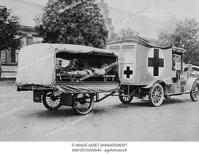 World War I 1914-1918: Wounded German soldiers on stretchers in a motorised ambulance painted with the Red Cross, Eatern Front, 1915