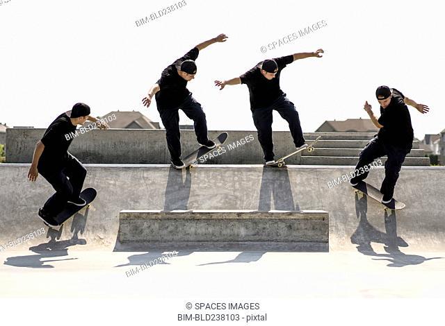 Multiple exposure of Caucasian man riding skateboard in skate park