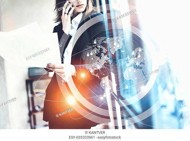 Photo business woman wearing black suit,talking smartphone and holding papers hands.Open space loft office.Panoramic windows background