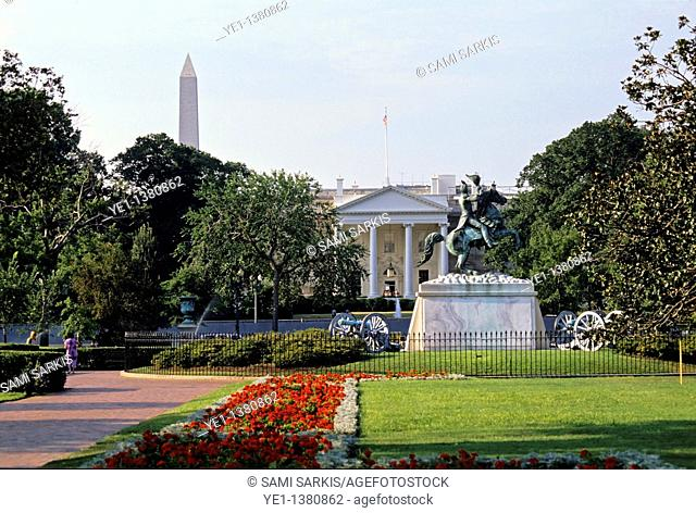 Gardens at the entrance to the White House with the obelisk of the Washington Monument seen in the background, Washington DC, USA
