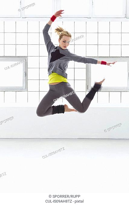 Young woman jumping in gymnasium