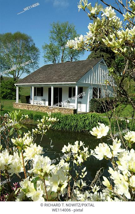 Whitewing Farm Bed and Breakfast, Chester County, Kennett Square, Pennsylvania, white wooden cottage with azalea flowers