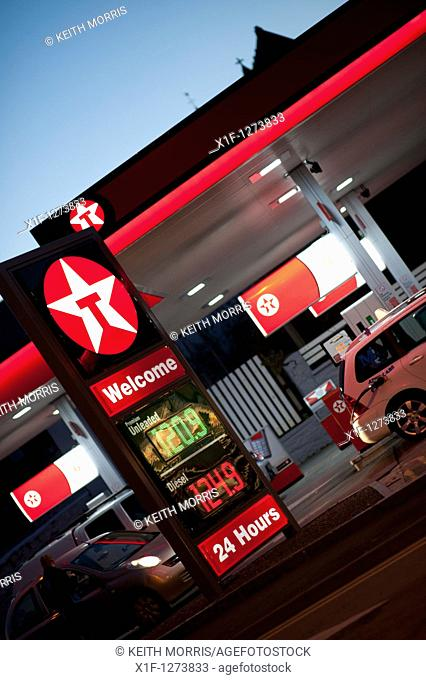 A Texaco petrol station garage at night, Aberystwyth Wales UK