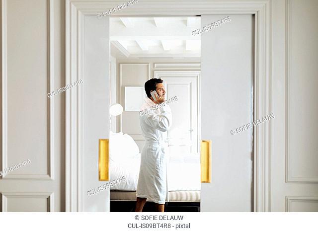 Man using smartphone in suite