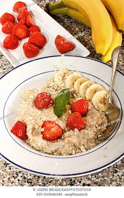 healthy porridge, scottish breakfast with strawberries and banana