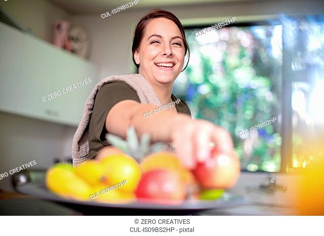Woman having fruits for breakfast at home