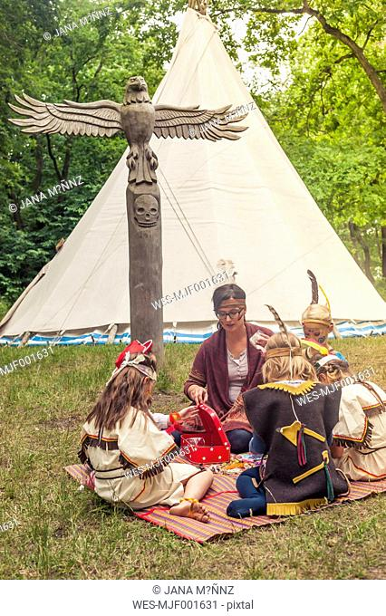 Germany, Saxony, Indians and cowboy party, Girls tinkering with beads