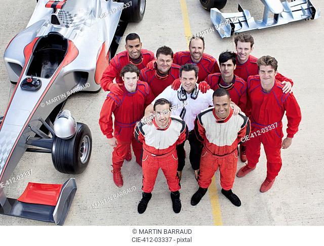Racing team smiling at pit stop