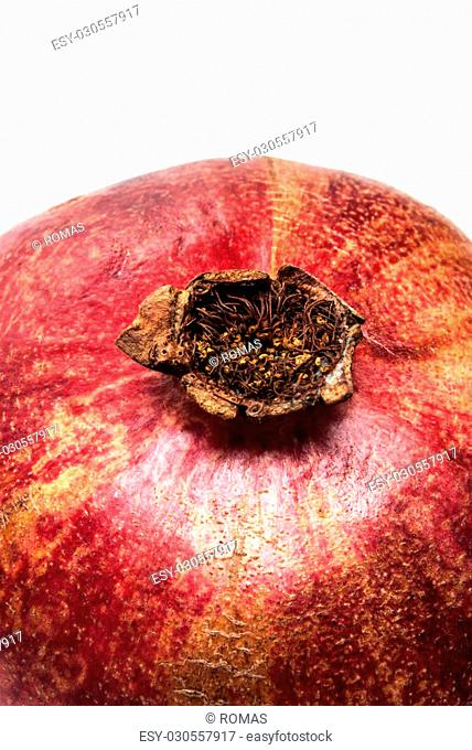 A pomegranate on a white background
