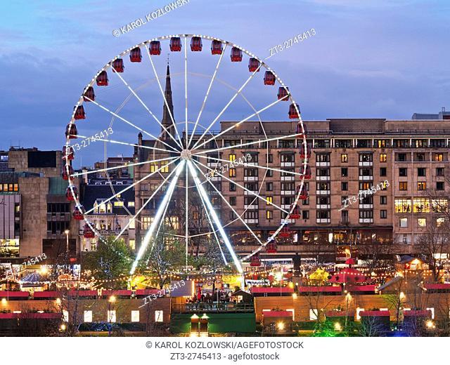 UK, Scotland, Lothian, Edinburgh, Twilight view of the Big Wheel on the Christmas Market on Princes Street