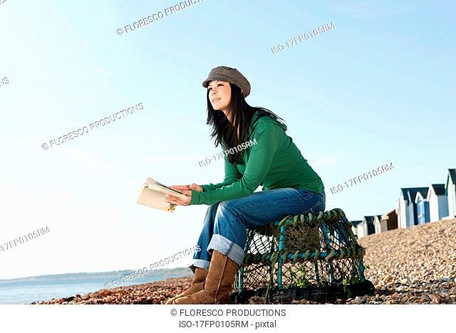 Young woman looking out to sea