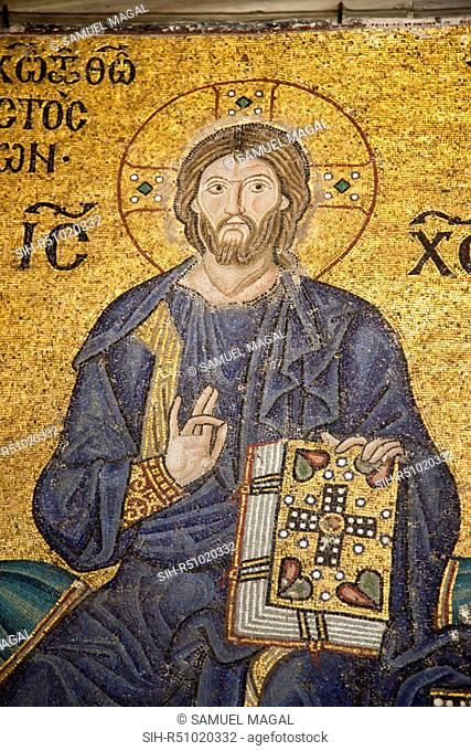 In this Mosaic Jesus holding his right hand in a gesture of blessing, while with his left hand the Holy book