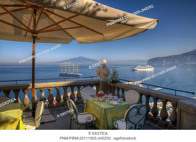 Bust on the balcony of a terrace with the sea in the background, Sorrento, Campania, Italy
