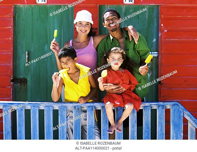 Family eating ice cream, parents smiling