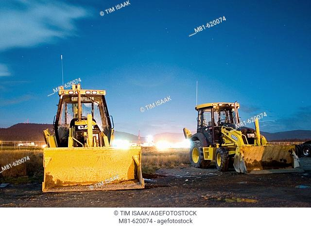 Wheel loaders in a yard at night. Sidney, British Columbia, Canada, 3 January 2007