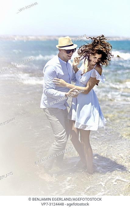 couple at beach, love, summer, holidays, playful