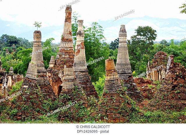 Ruined pagodas at Shwe Inn Thein Paya above Inthein on Inle Lake; Myanmar