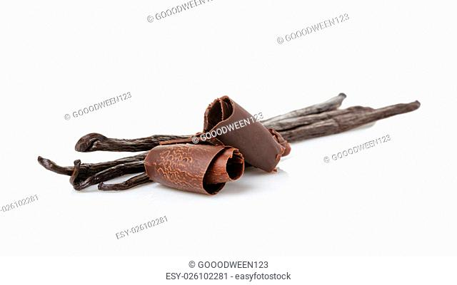 fresh bourbon vanilla pods and chocolate curls, isolated on white background