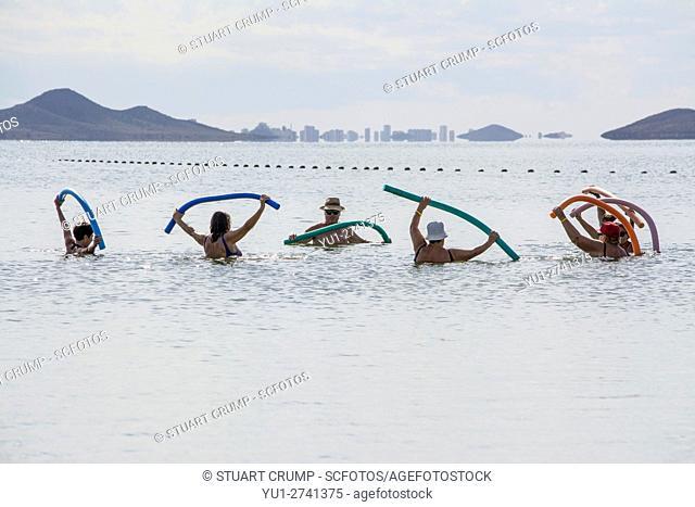 Excercising in the Mar Menor at Los Alcazares Beach in the region of Murcia, Costa Calida, Spain
