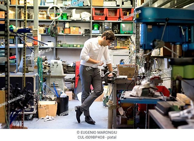 Man looking at work station in workshop