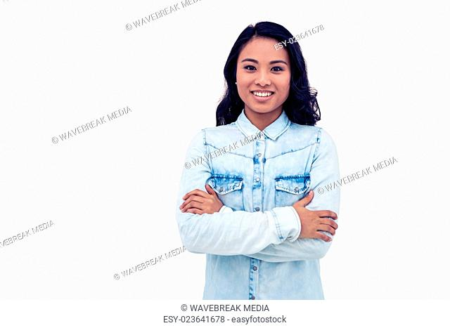 Asian woman with arms crossed smiling
