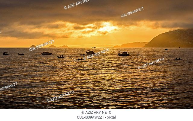 Silhouette of squid fishing boats on ocean, Cagarras Islands, Rio de Janeiro, Brazil