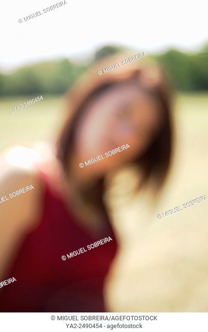 Blurred Female Figure in Park