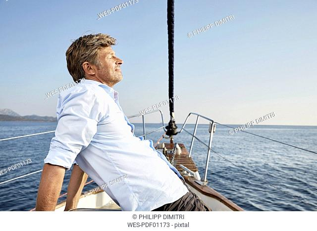 Mature man relaxing on his sailing boat
