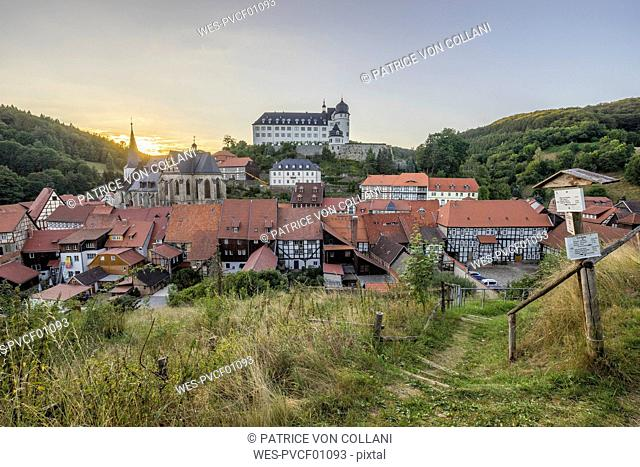 Germany, Saxony-Anhalt, Stolberg, townscape and Stolberg Castle in the evening