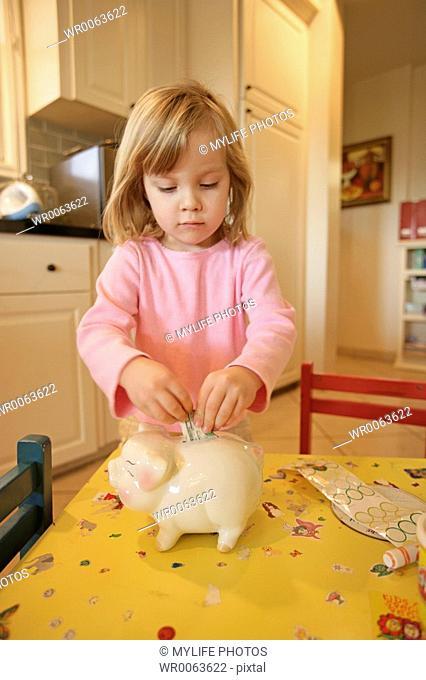 daughter and piggybank