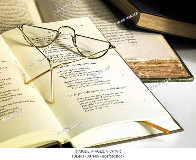 An open book and a pair of reading glasses
