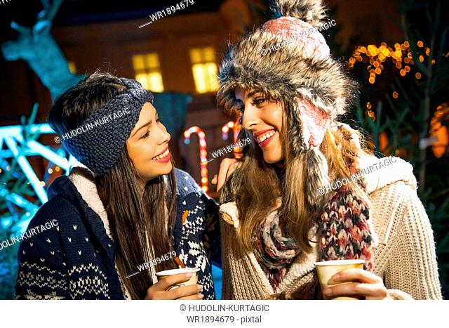 Two women having fun at Christmas Market