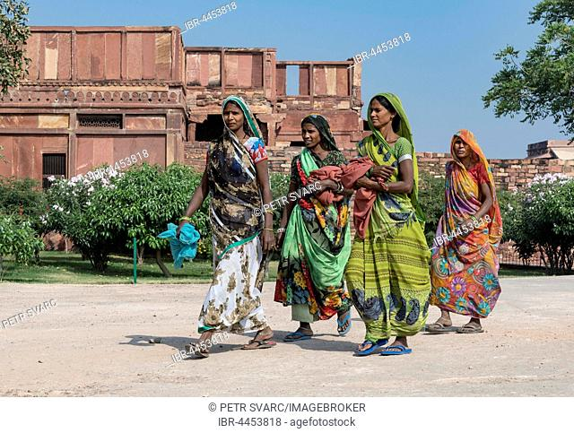 Indian women in traditional colorful sari dresses, Fatehpur Sikri, India