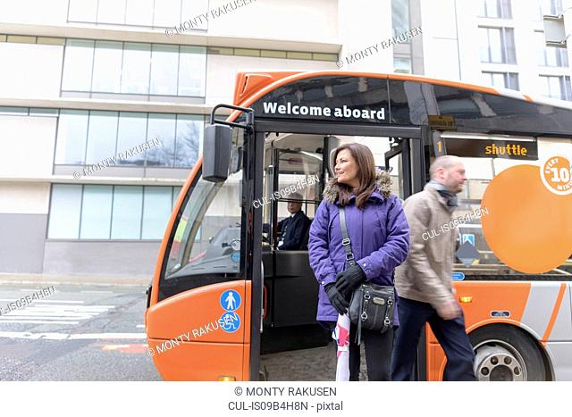 Passengers getting off electric bus