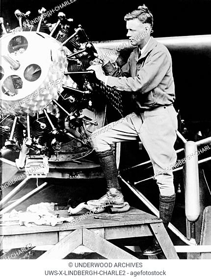 Roosevelt Field, New York: May, 1927.Captain Charles Lindbergh tuning up his plane, The Spirit of St. Louis, for his record setting non-stop flight across the...