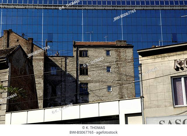 reflection of an old building in the glass facade of a new modern business building, Serbia-Montenegro, Belgrade