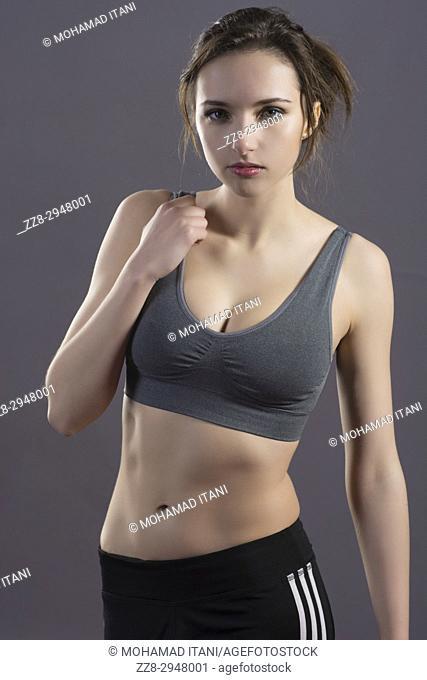 Beautiful young woman wearing a sports bra