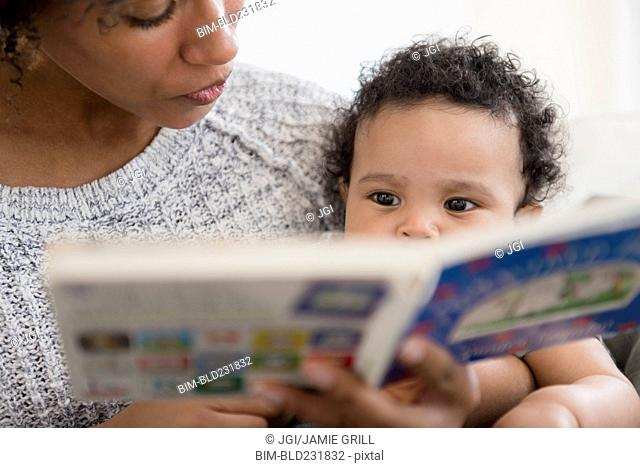 Mother reading book to baby son