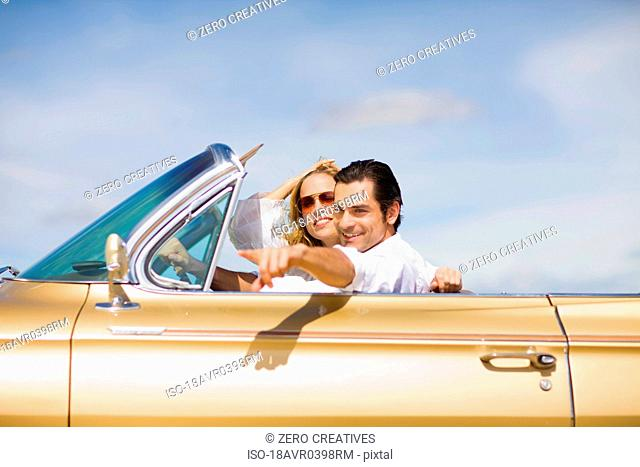 Young couple driving a convertible