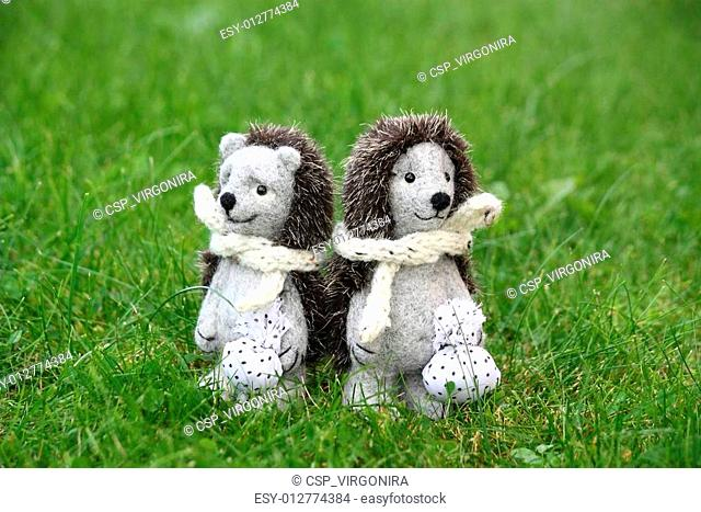 Two cute hedgehog toys in the park