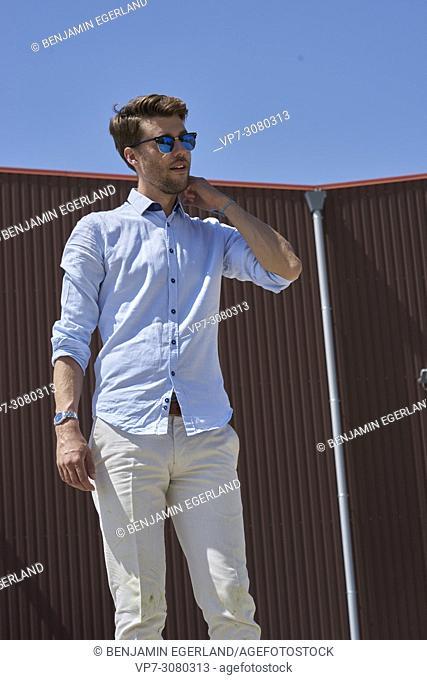 Portrait of Youtuber Axel Sprenger wearing sunglasses. In Germany, Bavaria