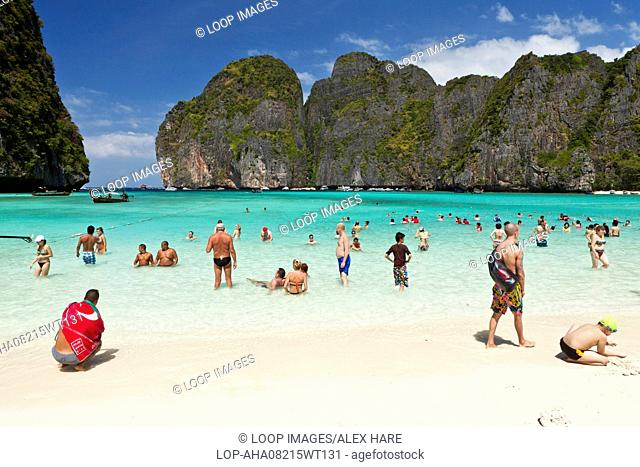 Tourists enjoying a swim in the crystal clear waters of Maya Bay