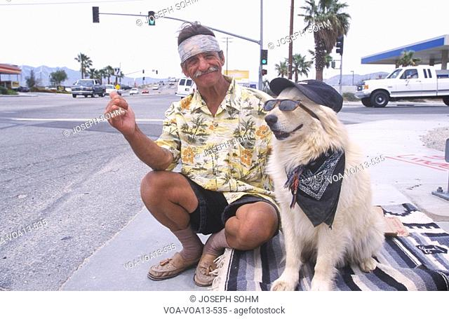 A homeless man and his dog will work for food