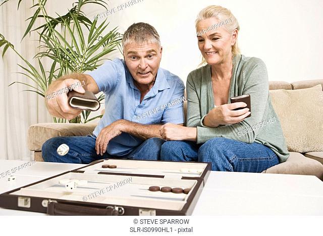 Couple playing backgammon