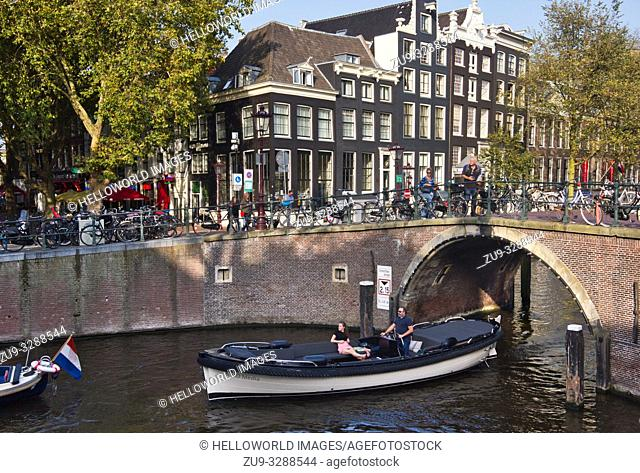 Tourist canal boat tours, Amsterdam, Holland