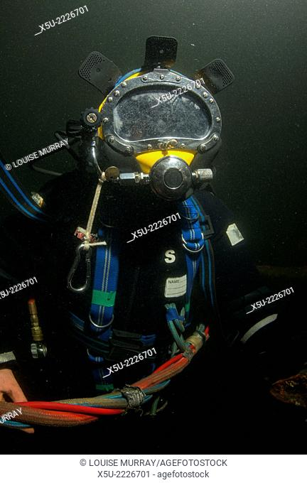 Commercial diver in training. Air, hot water and communications is supplied by a tether which links the diver to the surface or a closed bell