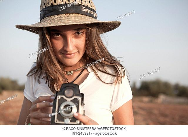 girl taking a picture with old camera, Peniscola, Spain