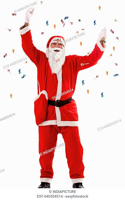 Santa Claus throwing sweets in air over white background
