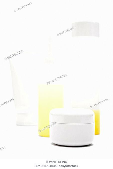 Various blank tubes, bottles and pots isolated on a white background