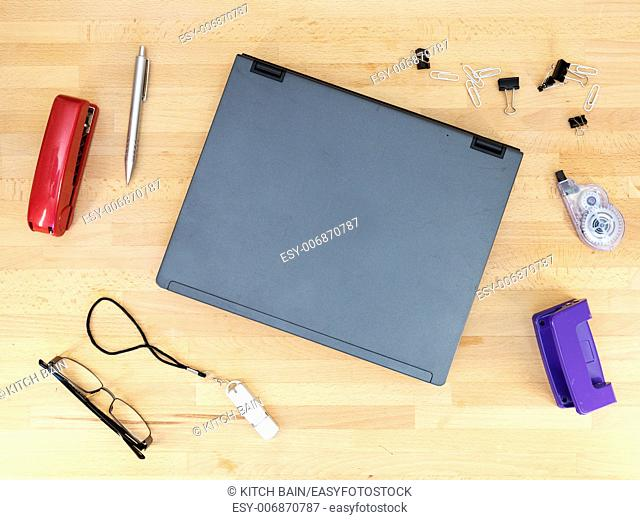 Stationery and work objects on a wooden office desk